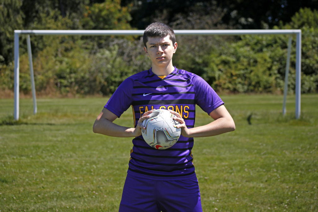 anacortes senior portrait session man with soccer ball at high school